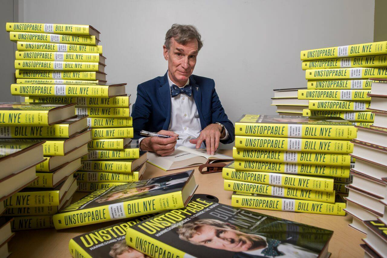Bill Nye signing books